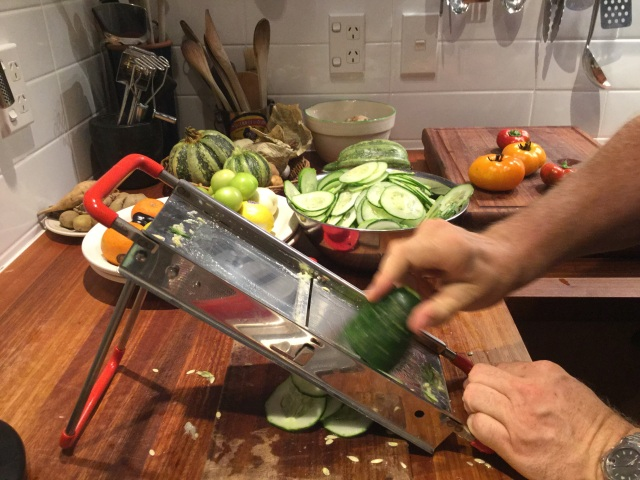 Cutting Cucumbers on a mandolin
