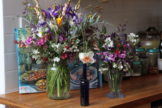 3 vases of flowers
