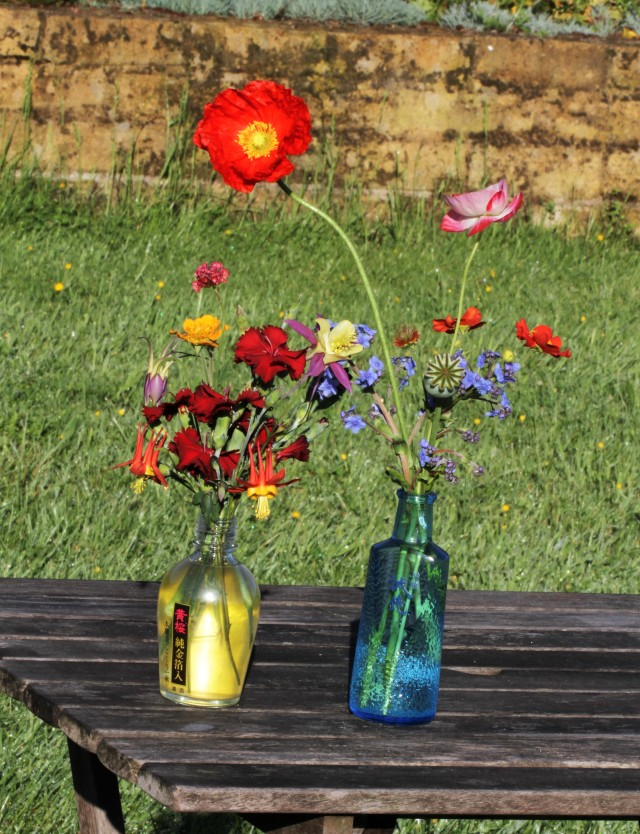 sake bottles with poppies and carnations