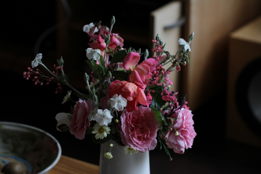 Roses in a jug inside