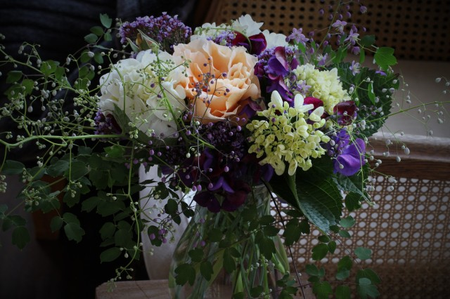 vase of Just Joey rose with hydrangeas thalictrum and sweet peas and statice