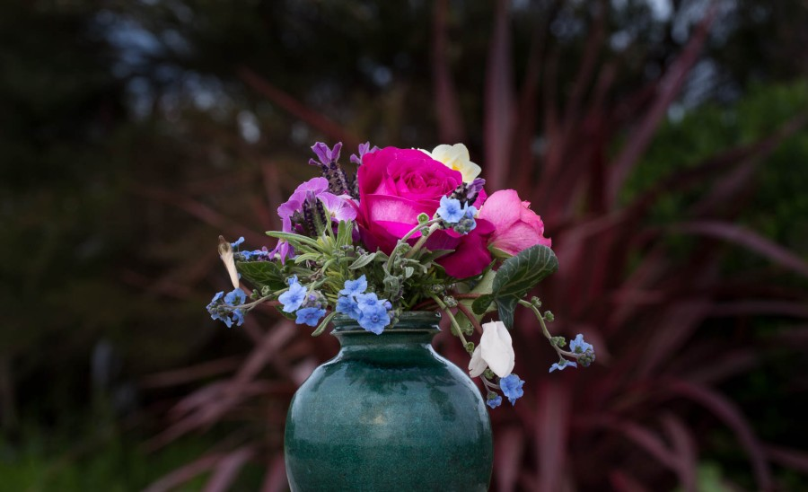 vase of roses with lavender chinese forgetmenot