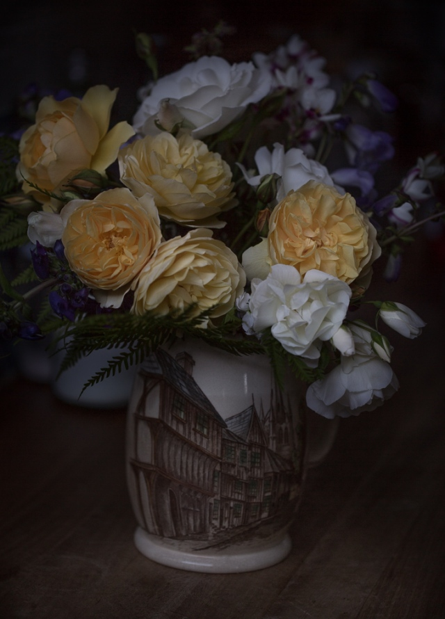 vase of yellow roses cut flowers