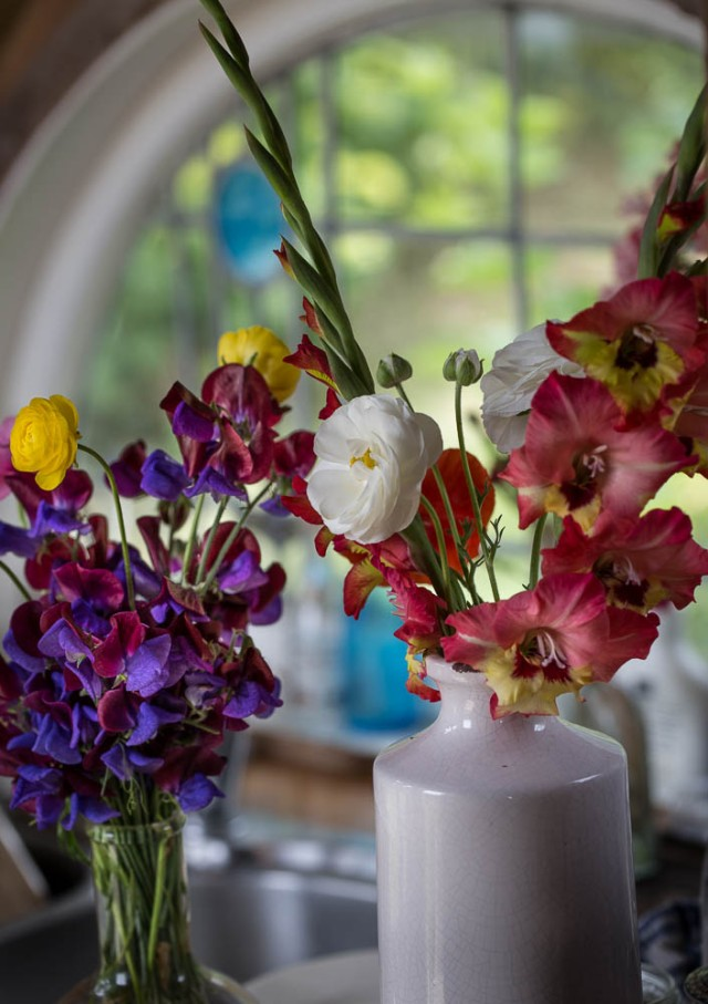 vase of flowers anemones and sweet peas