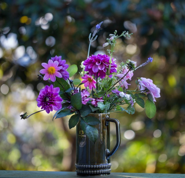 pink flowers in a vase with trees